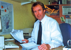 John Barrett MP in his constituency office